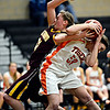 "Erie's Piper Zeier (53) competes for a rebound with Berthoud's Taylor Armitage (51) during the game at Erie High School on Thursday, Dec. 20, 2012. Erie beat Berthoud 30-27. For more photos visit  <a href=""http://www.BoCoPreps.com"">http://www.BoCoPreps.com</a>.<br /> (Greg Lindstrom/Times-Call)"