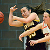 "Erie's Kenzie Kudrna (12) deflects a pass intended for Berthoud's Hannah Haggas (25) during the game at Erie High School on Thursday, Dec. 20, 2012. Erie beat Berthoud 30-27. For more photos visit  <a href=""http://www.BoCoPreps.com"">http://www.BoCoPreps.com</a>.<br /> (Greg Lindstrom/Times-Call)"