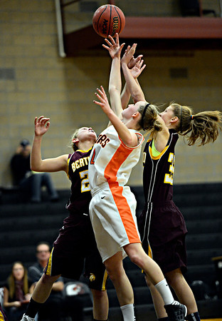 """Erie's Haley Gallagher, center, reaches for a rebound against Berthoud's Kendall Baker, left, and Kristina Cavey during the game at Erie High School on Thursday, Dec. 20, 2012. Erie beat Berthoud 30-27. For more photos visit  <a href=""""http://www.BoCoPreps.com"""">http://www.BoCoPreps.com</a>.<br /> (Greg Lindstrom/Times-Call)"""