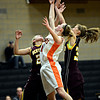 "Erie's Haley Gallagher, center, reaches for a rebound against Berthoud's Kendall Baker, left, and Kristina Cavey during the game at Erie High School on Thursday, Dec. 20, 2012. Erie beat Berthoud 30-27. For more photos visit  <a href=""http://www.BoCoPreps.com"">http://www.BoCoPreps.com</a>.<br /> (Greg Lindstrom/Times-Call)"