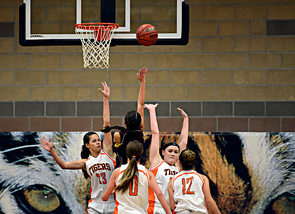 "Berthoud's Samantha Kouns goes up for a shot against Erie defenders during the game at Erie High School on Thursday, Dec. 20, 2012. Erie beat Berthoud 30-27. For more photos visit  <a href=""http://www.BoCoPreps.com"">http://www.BoCoPreps.com</a>.<br /> (Greg Lindstrom/Times-Call)"