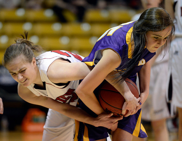 Fairview's Caroline McKee and Boulder's Jacque Szarmach battler for the ball in the second quarter Saturday night Jan. 19, 2013 at the Coors Events Center. (Lewis Geyer/Times-Call)