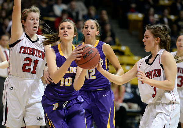 Boulder's Cara Aschbacher drives to the basket between Fairview's Megan McCambridge, left, and Katie Kuisman Saturday night Jan. 19, 2013 at the Coors Events Center. (Lewis Geyer/Times-Call)
