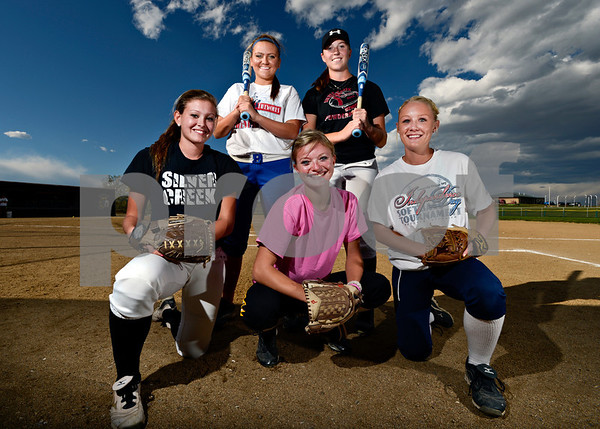 Silver Creek softball players, left to right, Haille Weber, MmcKenna Kostelecky, Devin Aubry, Shelby Keil and Macy Child pose for a portrait at Silver Creek High School in Longmont on Wednesday, Oct. 3, 2012.<br /> (Greg Lindstrom/Times-Call)