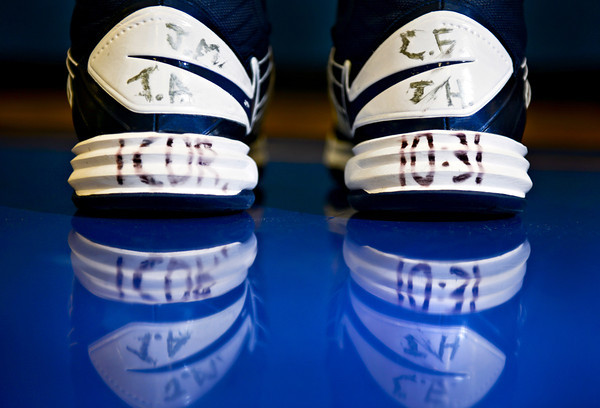 Initials on the back of Lucas Adams' shoes stand for Jordan McMullen, Tony Adams, Carlos Flores and Tyler Hoog. Also written on the bottom is the bible verse 1 Corinthians 10:31. Adams is pictured at Frederick High School on Wednesday, Jan. 30, 2013. <br /> (Greg Lindstrom/Times-Call)