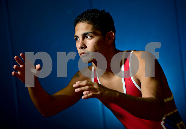 Senior Andre Aragon poses for a portrait at Centaurus High School on Friday, Nov. 16, 2012.<br /> (Greg Lindstrom/Times-Call)