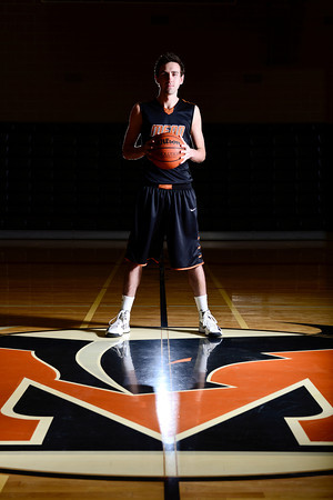 Mead High School's Ryan Lozinski poses for a portrait, Wednesday, Jan. 16, 2013, at MHS. Lozinski is among the best scorers in Class 4A basketball.<br /> (Composite Photo by Matthew Jonas/Times-Call)