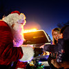"""Santa Claus greets Danika Bogle, 1, and her mother Chauntal Mast as he rides along with the Frederick-Firestone Fire Protection District during the first night of the Santa Run on Wednesday, Dec. 19, 2012. The Santa Run continues through Saturday. To see the scheduled routes of the Santa Run visit <a href=""""http://www.fffd.us/santa_run.htm"""">http://www.fffd.us/santa_run.htm</a>. For more photos and a video visit  <a href=""""http://www.TimesCall.com"""">http://www.TimesCall.com</a>.   <br /> (Greg Lindstrom/Times-Call)"""