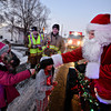 """Breanna Colvin, 8, left, her sister Brooklynn, 6, back, and brother Curtis, 5, receive candy canes from Santa Claus while he rides along with the Frederick-Firestone Fire Protection District during the first night of the Santa Run on Wednesday, Dec. 19, 2012. The Santa Run continues through Saturday. To see the scheduled routes of the Santa Run visit <a href=""""http://www.fffd.us/santa_run.htm"""">http://www.fffd.us/santa_run.htm</a>. For more photos and a video visit  <a href=""""http://www.TimesCall.com"""">http://www.TimesCall.com</a>.   <br /> (Greg Lindstrom/Times-Call)"""