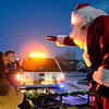 """Santa Claus greets Patrick Abbott, 2, and his mother Sarah as he rides along with the Frederick-Firestone Fire Protection District during the first night of the Santa Run on Wednesday, Dec. 19, 2012. The Santa Run continues through Saturday. To see the scheduled routes of the Santa Run visit <a href=""""http://www.fffd.us/santa_run.htm"""">http://www.fffd.us/santa_run.htm</a>. For more photos and a video visit  <a href=""""http://www.TimesCall.com"""">http://www.TimesCall.com</a>.   <br /> (Greg Lindstrom/Times-Call)"""