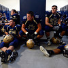 "Warrior players listen to the game plan from head coach Thad Lear in the locker room before the game.  Frederick beat Berthoud 41-14 during the game at Frederick High School on Friday, Sept. 14, 2012.  For more photos visit  <a href=""http://www.TimesCall.com"">http://www.TimesCall.com</a>.<br /> (Greg Lindstrom/Times-Call)"