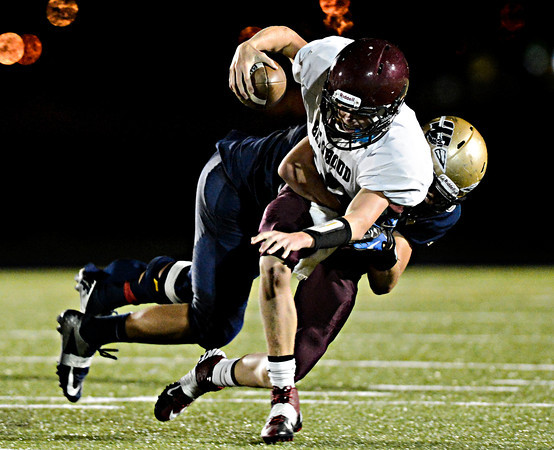 """Frederick's Jakob Vargas sacks Berthoud's Cody Braesch during the first half.  Frederick faces Berthoud at Frederick High School on Friday, Sept. 14, 2012.  For more photos visit  <a href=""""http://www.TimesCall.com"""">http://www.TimesCall.com</a>.<br /> (Greg Lindstrom/Times-Call)"""