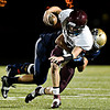 "Frederick's Jakob Vargas sacks Berthoud's Cody Braesch during the first half.  Frederick faces Berthoud at Frederick High School on Friday, Sept. 14, 2012.  For more photos visit  <a href=""http://www.TimesCall.com"">http://www.TimesCall.com</a>.<br /> (Greg Lindstrom/Times-Call)"