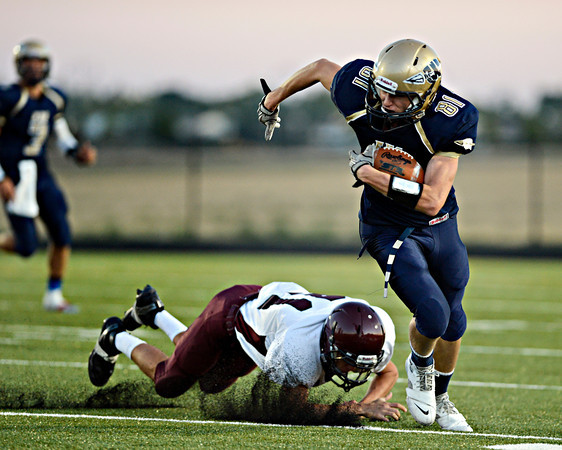 """Frederick's Joe Wise (81) runs past Berthoud's Jackson Hall during the first half.  Frederick faces Berthoud at Frederick High School on Friday, Sept. 14, 2012.  For more photos visit  <a href=""""http://www.TimesCall.com"""">http://www.TimesCall.com</a>.<br /> (Greg Lindstrom/Times-Call)"""