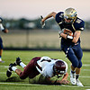 "Frederick's Joe Wise (81) runs past Berthoud's Jackson Hall during the first half.  Frederick faces Berthoud at Frederick High School on Friday, Sept. 14, 2012.  For more photos visit  <a href=""http://www.TimesCall.com"">http://www.TimesCall.com</a>.<br /> (Greg Lindstrom/Times-Call)"