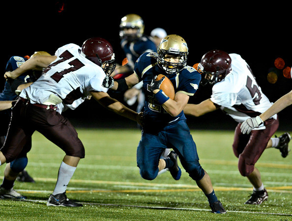 "Frederick's Xavier Lindberg runs through the Berthoud defense during the second half.  Frederick beat Berthoud 41-14 during the game at Frederick High School on Friday, Sept. 14, 2012.  For more photos visit  <a href=""http://www.TimesCall.com"">http://www.TimesCall.com</a>.<br /> (Greg Lindstrom/Times-Call)"