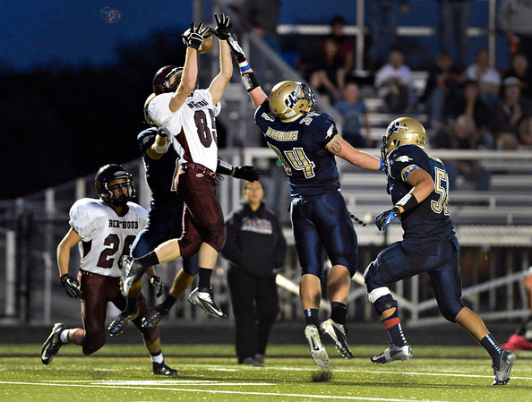 "Berthoud's Ryan DeMoudt (85) and Frederick's Ryan Miller (34) compete for a ball in the first half.  The ball was tipped and caught by Berthoud's Alexander Kingsley, far left, who scored on the play.  Frederick beat Berthoud 41-14 during the game at Frederick High School on Friday, Sept. 14, 2012.  For more photos visit  <a href=""http://www.TimesCall.com"">http://www.TimesCall.com</a>.<br /> (Greg Lindstrom/Times-Call)"