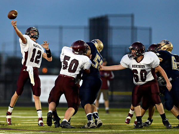 """Berthoud's Cody Braesch (12) throws to a teammate in the first half.  Frederick beat Berthoud 41-14 during the game at Frederick High School on Friday, Sept. 14, 2012.  For more photos visit  <a href=""""http://www.TimesCall.com"""">http://www.TimesCall.com</a>.<br /> (Greg Lindstrom/Times-Call)"""