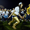 "Frederick students, including Brooklin Lebon, center, storm the field after the Warriors' victory.  Frederick beat Berthoud 41-14 during the game at Frederick High School on Friday, Sept. 14, 2012.  For more photos visit  <a href=""http://www.TimesCall.com"">http://www.TimesCall.com</a>.<br /> (Greg Lindstrom/Times-Call)"