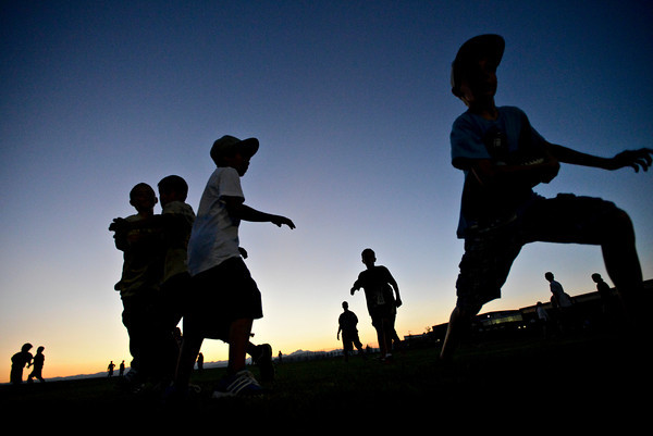 """Young kids play their own football games outside the staduim.  Frederick beat Berthoud 41-14 during the game at Frederick High School on Friday, Sept. 14, 2012.  For more photos visit  <a href=""""http://www.TimesCall.com"""">http://www.TimesCall.com</a>.<br /> (Greg Lindstrom/Times-Call)"""