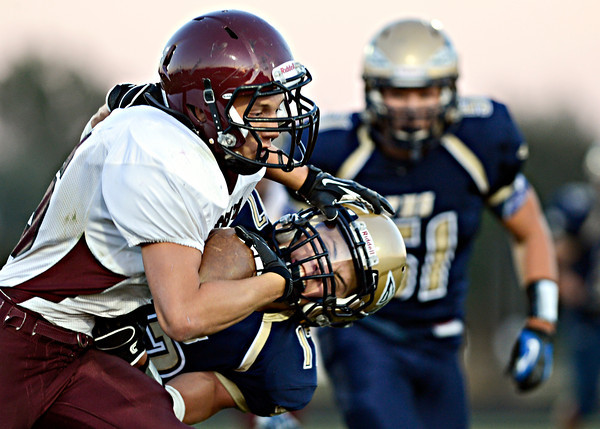 "Berthoud's Alexander Kingsley stiff-arms Frederick's Jacob Sleeth during the first half.  Frederick faces Berthoud at Frederick High School on Friday, Sept. 14, 2012.  For more photos visit  <a href=""http://www.TimesCall.com"">http://www.TimesCall.com</a>.<br /> (Greg Lindstrom/Times-Call)"