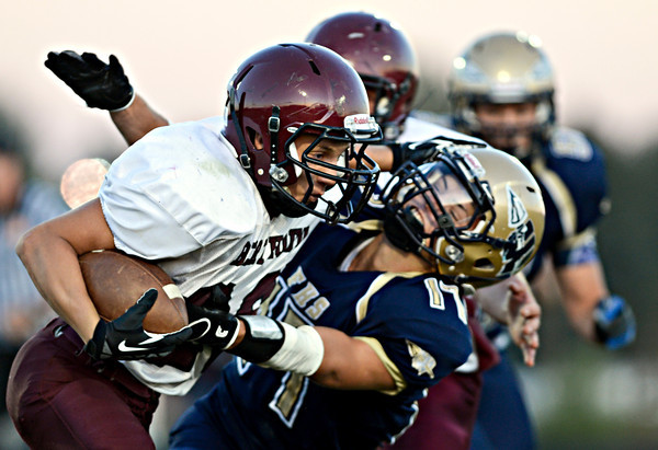 """Berthoud's Alexander Kingsley stiff-arms Frederick's Jacob Sleeth during the first half.  Frederick faces Berthoud at Frederick High School on Friday, Sept. 14, 2012.  For more photos visit  <a href=""""http://www.TimesCall.com"""">http://www.TimesCall.com</a>.<br /> (Greg Lindstrom/Times-Call)"""