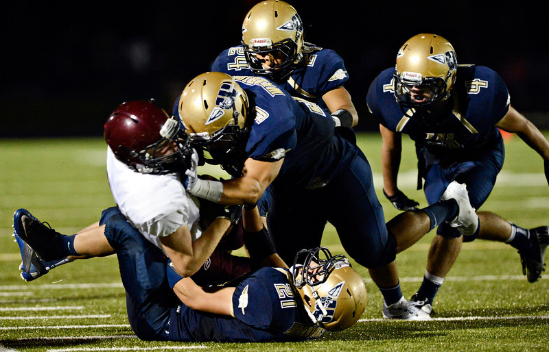 """The Warrior defense makes a stop in the second half.  Frederick beat Berthoud 41-14 during the game at Frederick High School on Friday, Sept. 14, 2012.  For more photos visit  <a href=""""http://www.TimesCall.com"""">http://www.TimesCall.com</a>.<br /> (Greg Lindstrom/Times-Call)"""