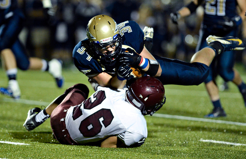 "Frederick's Ryan Miller (34) holds on to the ball as he collides with Berthoud's Alexander Kingsley (26) during the second half.  Frederick beat Berthoud 41-14 during the game at Frederick High School on Friday, Sept. 14, 2012.  For more photos visit  <a href=""http://www.TimesCall.com"">http://www.TimesCall.com</a>.<br /> (Greg Lindstrom/Times-Call)"