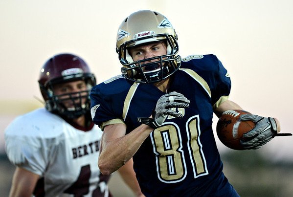 "Frederick's Joe Wise (81) runs past the Berthoud defense in the first half.  Frederick beat Berthoud 41-14 during the game at Frederick High School on Friday, Sept. 14, 2012.  For more photos visit  <a href=""http://www.TimesCall.com"">http://www.TimesCall.com</a>.<br /> (Greg Lindstrom/Times-Call)"