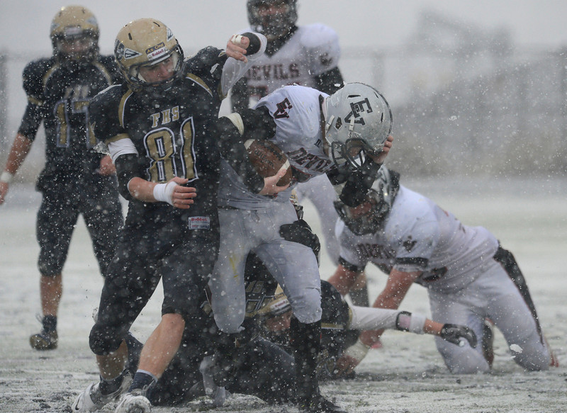 Eagle Valley's Cole Nielsen carries the ball next to Frederick's Joe Wise Saturday Nov. 10, 2012 at Frederick High School. (Lewis Geyer/Times-Call)