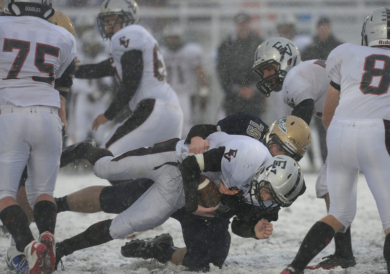 Frederick's Jeremiah Pope tackles Eagle Valley's Cole Nielsen Saturday Nov. 10, 2012 at Frederick High School. (Lewis Geyer/Times-Call)