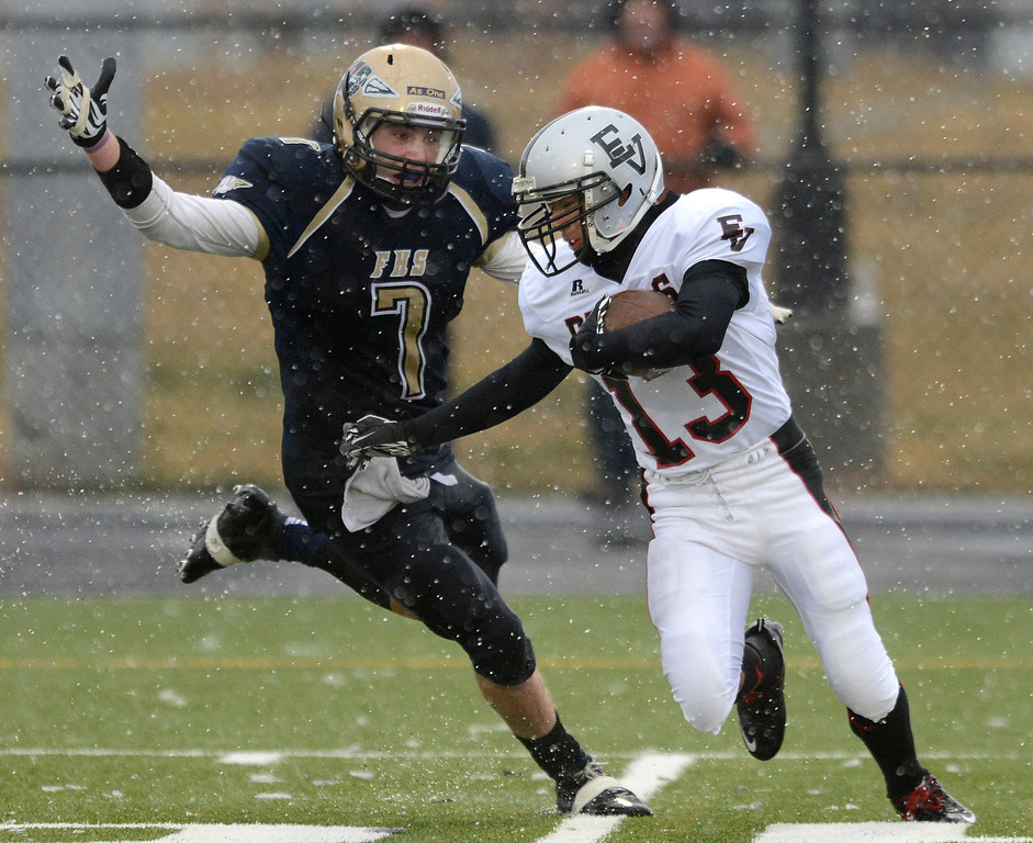 Eagle Valley's Joel Gardea returns an interception intended for Frederick's Michael Broz Saturday Nov. 10, 2012 at Frederick High School. (Lewis Geyer/Times-Call)