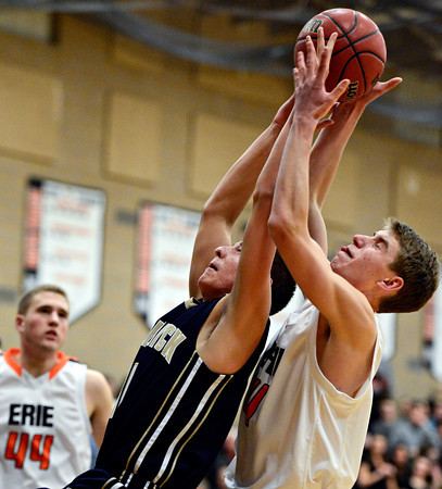"Frederick's Austin Rivera, left, and Erie's Kyle Leahy compete for a rebound during the game at Erie High School on Friday, Feb. 8, 2013. Frederick beat Erie 59-52. For more photos visit  <a href=""http://www.BoCoPreps.com"">http://www.BoCoPreps.com</a>.<br /> (Greg Lindstrom/Times-Call)"