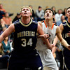"Frederick's Ryan Miller (34) boxes out Erie'd Dylan Brink during the game at Erie High School on Friday, Feb. 8, 2013. Frederick beat Erie 59-52. For more photos visit  <a href=""http://www.BoCoPreps.com"">http://www.BoCoPreps.com</a>.<br /> (Greg Lindstrom/Times-Call)"