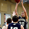 "Frederick's Alex Therrien (20) shoots over Erie's Jesse Tallman during the game at Erie High School on Friday, Feb. 8, 2013. Frederick beat Erie 59-52. For more photos visit  <a href=""http://www.BoCoPreps.com"">http://www.BoCoPreps.com</a>.<br /> (Greg Lindstrom/Times-Call)"