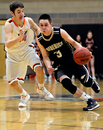 """Frederick's Lucas Adams (3) drives past Erie's Dylan Brink during the game at Erie High School on Friday, Feb. 8, 2013. Frederick beat Erie 59-52. For more photos visit  <a href=""""http://www.BoCoPreps.com"""">http://www.BoCoPreps.com</a>.<br /> (Greg Lindstrom/Times-Call)"""