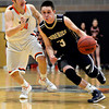 "Frederick's Lucas Adams (3) drives past Erie's Dylan Brink during the game at Erie High School on Friday, Feb. 8, 2013. Frederick beat Erie 59-52. For more photos visit  <a href=""http://www.BoCoPreps.com"">http://www.BoCoPreps.com</a>.<br /> (Greg Lindstrom/Times-Call)"