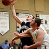 "Frederick's Joe Wise (12) has a shot blocked by Erie's Jesse Tallman during the game at Erie High School on Friday, Feb. 8, 2013. Frederick beat Erie 59-52. For more photos visit  <a href=""http://www.BoCoPreps.com"">http://www.BoCoPreps.com</a>.<br /> (Greg Lindstrom/Times-Call)"