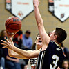 """Erie's Dylan Brink (14) goes up for a shot over Frederick's Lucas Adams (3) during the game at Erie High School on Friday, Feb. 8, 2013. Frederick beat Erie 59-52. For more photos visit  <a href=""""http://www.BoCoPreps.com"""">http://www.BoCoPreps.com</a>.<br /> (Greg Lindstrom/Times-Call)"""