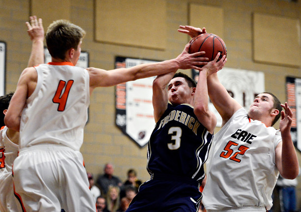 """Frederick's Lucas Adams (3) goes up for a shot as Erie's Jesse Tallman (52) and Kyle Leahy (4) defend during the game at Erie High School on Friday, Feb. 8, 2013. Frederick beat Erie 59-52. For more photos visit  <a href=""""http://www.BoCoPreps.com"""">http://www.BoCoPreps.com</a>.<br /> (Greg Lindstrom/Times-Call)"""