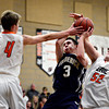 "Frederick's Lucas Adams (3) goes up for a shot as Erie's Jesse Tallman (52) and Kyle Leahy (4) defend during the game at Erie High School on Friday, Feb. 8, 2013. Frederick beat Erie 59-52. For more photos visit  <a href=""http://www.BoCoPreps.com"">http://www.BoCoPreps.com</a>.<br /> (Greg Lindstrom/Times-Call)"