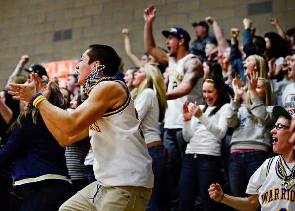 "Frederick fans celebrate after a dunk by Joe Wise during the game at Erie High School on Friday, Feb. 8, 2013. Frederick beat Erie 59-52. For more photos visit  <a href=""http://www.BoCoPreps.com"">http://www.BoCoPreps.com</a>.<br /> (Greg Lindstrom/Times-Call)"