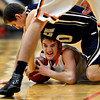 "Erie's Dylan Brink, center, and Frederick's Alex Therrien (20) compete for a loose ball during the game at Erie High School on Friday, Feb. 8, 2013. Frederick beat Erie 59-52. For more photos visit  <a href=""http://www.BoCoPreps.com"">http://www.BoCoPreps.com</a>.<br /> (Greg Lindstrom/Times-Call)"