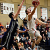 "Erie's Coltin Brink (5) goes up for a shot over Frederick's Jayden McGraw during the game at Erie High School on Friday, Feb. 8, 2013. Frederick beat Erie 59-52. For more photos visit  <a href=""http://www.BoCoPreps.com"">http://www.BoCoPreps.com</a>.<br /> (Greg Lindstrom/Times-Call)"