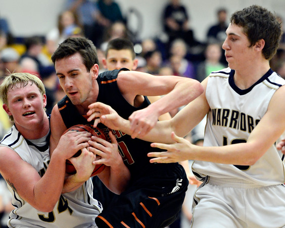 "Frederick's Ryan Miller, left, and Michael Broz compete for a rebound against Mead's Ryan Lozinski during the game at Frederick High School on Friday, Feb. 1, 2013. Frederick beat Mead 50-40. For more photos visit  <a href=""http://www.BoCoPreps.com"">http://www.BoCoPreps.com</a><br /> (Greg Lindstrom/Times-Call)"