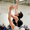 """Mead's Ryan Lozinski goes up for a shot over Frederick's Christian Martinez (23) during the game at Frederick High School on Friday, Feb. 1, 2013. Frederick beat Mead 50-40. For more photos visit  <a href=""""http://www.BoCoPreps.com"""">http://www.BoCoPreps.com</a><br /> (Greg Lindstrom/Times-Call)"""