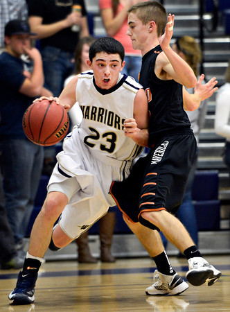 "Frederick's Christian Martinez (23) drives past Mead's Taylor Desch (3) during the game at Frederick High School on Friday, Feb. 1, 2013. Frederick beat Mead 50-40. For more photos visit  <a href=""http://www.BoCoPreps.com"">http://www.BoCoPreps.com</a><br /> (Greg Lindstrom/Times-Call)"