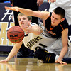 """Frederick's Nathan Harrison (21) and Mead's Walker Korell compete for a loose ball during the game at Frederick High School on Friday, Feb. 1, 2013. Frederick beat Mead 50-40. For more photos visit  <a href=""""http://www.BoCoPreps.com"""">http://www.BoCoPreps.com</a><br /> (Greg Lindstrom/Times-Call)"""