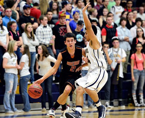 "Mead's Aaron Cheung (2) tries to drive past Frederick's Zach Gomez during the game at Frederick High School on Friday, Feb. 1, 2013. Frederick beat Mead 50-40. For more photos visit  <a href=""http://www.BoCoPreps.com"">http://www.BoCoPreps.com</a><br /> (Greg Lindstrom/Times-Call)"