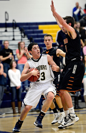 "Frederick's Christian Martinez (23) tries to drive past Mead's Taylor Desch, back, and Ryan Lozinski, right, during the game at Frederick High School on Friday, Feb. 1, 2013. Martinez was whistled for stepping out of bounds. Frederick beat Mead 50-40. For more photos visit  <a href=""http://www.BoCoPreps.com"">http://www.BoCoPreps.com</a><br /> (Greg Lindstrom/Times-Call)"